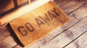 Front door mat reading 'go away'